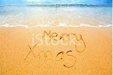 merry christmas written in the sand stock photos freeimages com