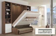 table qui se replie contre le mur le lit escamotable une solution gain de place espace