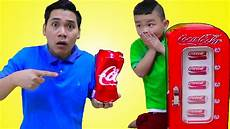 lyndon playing w coca cola coke vending machine toy for