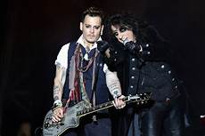 Johnny Depp Performs With Band Vires Amid