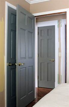 painted gray doors guest room and hall