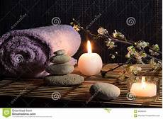 massaggio con le candele almond flowers with candles white stones on bamboo mat