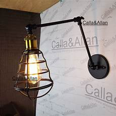 adjustable swing arm wall light fixture iron cage