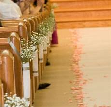 wedding bells flowers arches and church pews