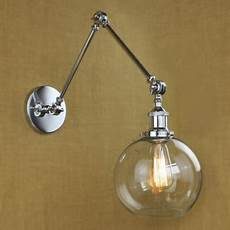 adjustable led wall light in chrome with round clear glass shade beautifulhalo com