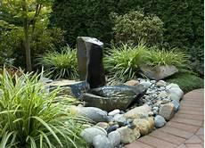Simple Basalt Column Water Feature With Adjacent Dishbowl