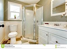 Great Blend Of White Bathroom Cabinets With Olive Walls