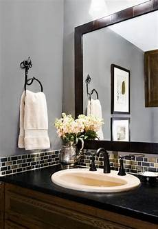 bathroom wall tile ideas for small bathrooms mosaic tile border and black framed mirror with the gray blue walls so home