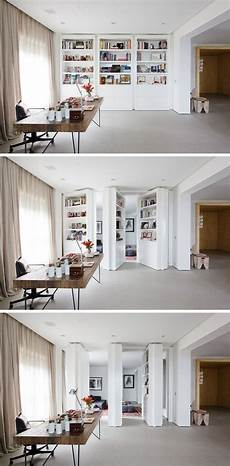 invisible doors turn a modern home into an artistic feat of these 13 secret doors are in plain sight