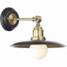 dar lighting hannover single light wall fixture in black and brass finishes castlegate