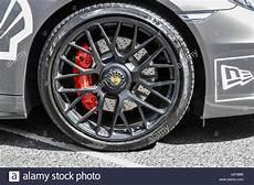 disc brake calipers on the front wheel of a porsche