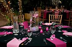 pink and black wedding reception decor like the centrepiece and table decor flower floating