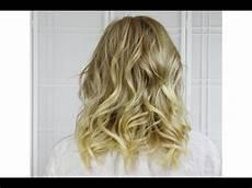 curl to medium length hair with flat iron