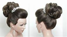 beautiful wedding bun hairstyle with puff for long hair