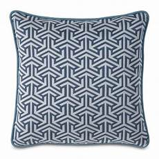 adding interest to neutral add eye interest to a neutral sofa with a graphic pillow