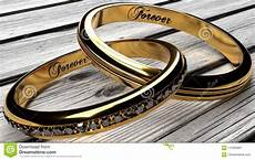 two joined golden wedding rings a wooden table stock image image of everlasting happy