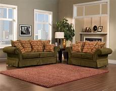pleasureable olive green fabric traditional sofa with cushions as well as grey wall painted