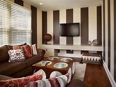 Tv Room With Brown And Striped Walls Hgtv