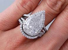 5 14 ctw pear shape diamond wedding ring f i1 includes a matching wedding ring