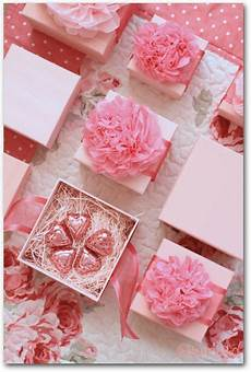 for the insides of the wedding favours some shredded coloured paper as fillers pink gifts