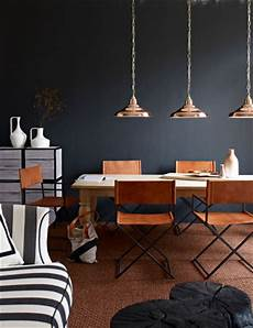 love these copper light fixtures and navy blue walls together pinterest home decor