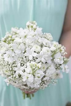 learn how to create an elegant babies breath wedding bouquet diy wedding bouquet flower