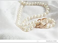 Wedding Background: Pearls And Wedding Bangs On A Fabric.