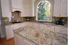 traditional style kitchen with granite countertops and a