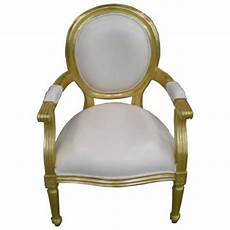 fauteuil cabriolet dore et imitation cuir blanc fauteuil