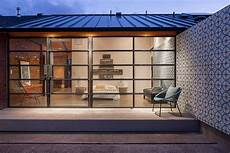 Glass And Metal Addition Transforms 1920s Bungalow In