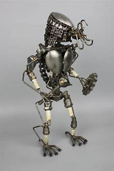 amazing metal sculptures made from reclaimed bronze metal model is made from scrap recycled metal and auto
