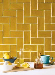 these earthier mustard yellow tiles are a certain way to create an interesting kitchen more