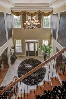 grand foyer grand foyer boasts lofty ceiling and chandelier hgtv