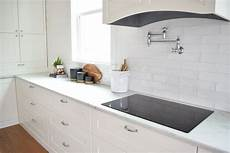 white ceiling fan subway kitchen backsplash ideas white modern farmhouse kitchen with wavy white subway tile