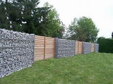 Mauer Aus Holz - steinmauer rembart holz im garten
