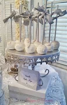 white and silver cake pops at a glam engagement party see more party planning ideas at