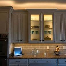 Kitchen Cupboard Lighting Ideas by Led Lighting Above Cabinet And Inside Glass Cabinet