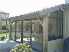 fermeture d une terrasse bois avec des chassis aluminium