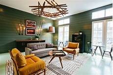 a mid century inspired apartment with modern geometric green midcentury modern clubhouse gathering room hgtv
