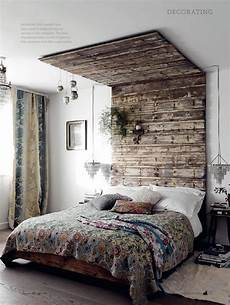 wooden pallet headboard that goes all the way to the top edgy yet homely feels