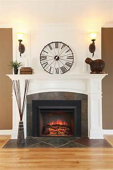 fireplace with wall sconces and clock good fireplace lighting ideas wearefound home design