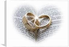 wedding rings an open bible canvas print by pete holloway