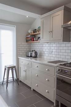 putty coloured units retro metro white tiles white worktop down lights kitchen renovation