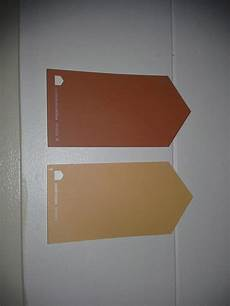 sherwin williams copper mountain and honeycomb orange navy pallette dining room paint
