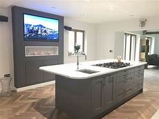 Kitchen Island With Hob And Seating by Kitchen Island With Feature Entertainment Backdrop