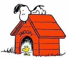 snoopy dog house plans snoopy on top of his doghouse with woodstock sitting in