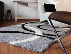 teppich hochflor shaggy linien muster grau schwarz weiss