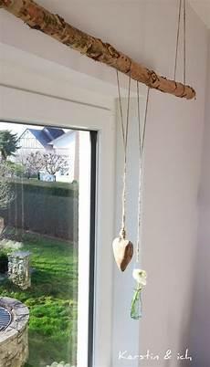 vorhang aufhängen möglichkeiten baumstamm als gardienenstange wohnen