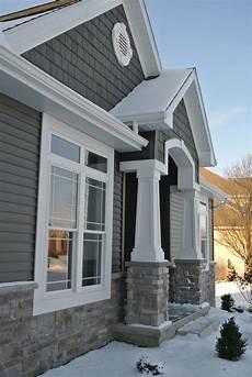 exterior stoned wainscot and front entry pillars hton gray ridgestone j n stone stone style