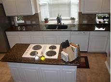 tropical brown granite with white cabinets grey backsplash search kitchen pinterest